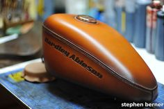 A leather covered gas tank done by Xian Leather. I want to see what the motorcycle looks like that this went on.