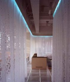 Curtains dividing a room using ceiling mounted curtain tracks