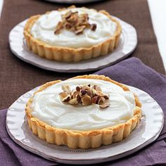 These creamy, nutty tarts received our Test Kitchens' highest rating. They're easy and fast for every day, but because this dessert needs time to Best White Chocolate, White Chocolate Desserts, Chocolate Hazelnut, Tart Recipes, Sweet Recipes, Dessert Recipes, Drink Recipes, Sweet Desserts, Delicious Desserts