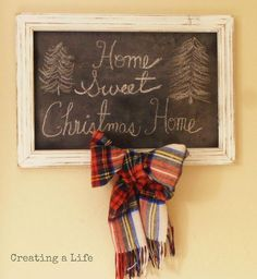 christmas cheater chalkboard, chalkboard paint, christmas decorations, crafts, seasonal holiday decor, A thrift store scarf that we ve had for many years adds a touch of perfect Christmas plaid It s attached to the frame with a thumb tack through the back of the bow Simple free and cute Christmas Winter decor