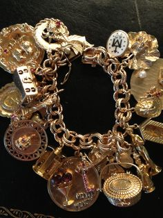 Charm Bracelet..always wanted a GOLD charm bracelet.