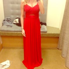 Red Prom dress ! Long Red prom dress, V neck, sheer cut outs on sides back and in the middle, crossed back, top fits tightly but it's loose from the waist down. Very comfortable and pretty !! Cache Dresses Maxi
