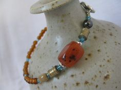 A bead bracelet in amber and turquoise by Trudysbeads on Etsy