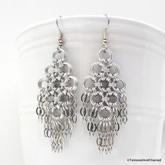 These stunning chainmaille earrings were handwoven using lightweight silver aluminum jump rings in several sizes. The flat chainmaille Japanese weave was formed