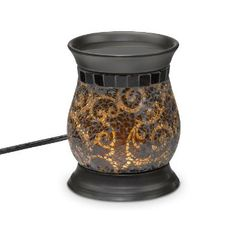 """Enjoy the Amaretto Swirl experience without the flame. Our electric warmer features a ceramic warming plate to diffuse the fragrance of Scent Plus® Melts or scented oil, sold separately. A hidden LED light sets the swirls of crushed glass aglow. Black cord. 6""""h, 4 3/4""""dia."""