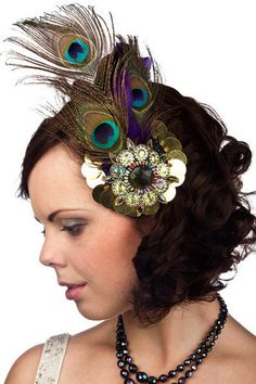 Sarah Harman: A classy but dramatic wearable Fascinator Handmade By Red's Ribbons, an aspiring miliner. made with gold plastic beads and sequins on a glitter canvas base and highlighted with peacock plumes and purple turkey feathers. all hand sewn with golden thread.