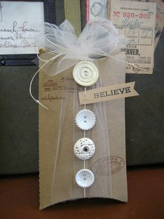 Make a pillow box like those in previous post. This one is made with chipboard and stamped with 7gypsies Avignon stamp. Use white waxed by lorie