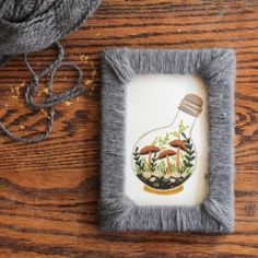 Add texture to your picture frames by wrapping them with yarn.