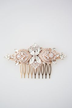 I have made this gorgeous wedding hair comb with mix of vintage settings and cubic zirconia components and given the that lovely Lulu Splendor twist turning into something new and exciting. A perfect key piece to accent and compliment your wedding gown. All handmade in my studio and unique to Lulu Splendor. - - - - - - - - - - - - - - - - - - - - - - - - - - - - - - Measurement: Length 4 inches Width 1 5/8 inches  Colors & Materials: High Quality Rose Gold Finish Clear Swarovski Crystal…