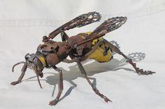 http://fantastisch.co/artiest-maakt-prachtige-kunstwerken-stukken-metalen-afval-op-straat-vind-adembenemend-mooi/