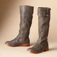A new riff on the classic riding boot in soft, supple, textured lambskin. Cuffed and detailed with double buckles and zippers. Imported. Whole or half sizes 6 to 10, 11.
