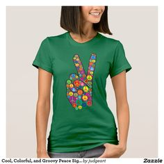 Cool, Colorful, and Groovy Peace Signs T-shirt. Looking for a little more peace in the world? Or do you want to send out some groovy 60s vibes? Then spread a little of both with this cool and colorful design that features a hand making the peace sign while filled up with many colorful peace symbols.