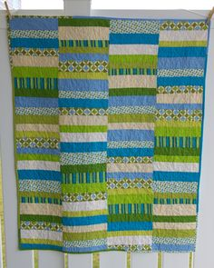 Simple quilt. Just make strips all the same length but could all be different widths.  not much measuring involved. My cup of tea.