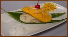 Thai Desserts- Mango with Sweet Rice dipped in coconut sauce.