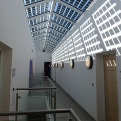 JMA-Belvidere family centre. Light filled communal corridor with double height spaces for a light open feel