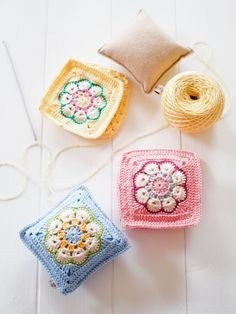 Ooooo pretty! Pin Cushions – no pattern here, but simple enough. An African Flower granny square on each side with small stuffed square inside. From Messyla.