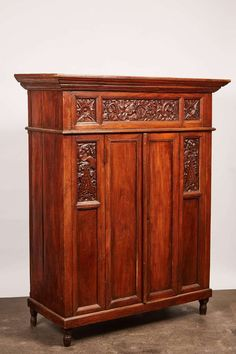 For Sale on - A unique Indonesian cabinet with a flaring cornice above a highly decorative frieze featuring complex carvings of foliage and dragon designs. Indonesian Decor, Dragon Design, Cornice, Teak, Two By Two, Carving, Shelves, Cabinet, Storage