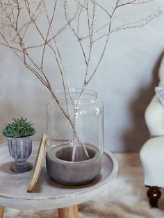 Milo Vase // Decorate your home with your favourite plants in this rustic hurricane vase from Cox and Cox. With a concrete earthenware base and glass top, this textured vase looks great in any setting.