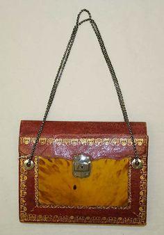 Amazingly modern looking purse  Date: 1800–1810 Culture: European Medium: leather, metal