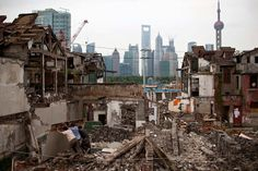 Workers demolish a residential site in downtown Shanghai on September 5, 2012. (Aly Song/Reuters) #