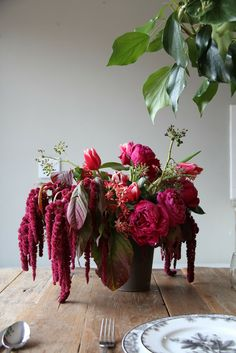 Wild winter centerpiece in dark pinks by Sarah Winward.