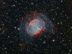 """In 1764, Charles Messier discovered this celestial object, M27, the Dumbbell Nebula. The image shown here represents an international collaboration between Andre van der Hoeven in Holland, Fred Herrmann in Alabama and Terry Hancock in Fremont, Michigan. Says Hancock, """"Using narrow band filters and very long exposures we were able to capture the outer hydrogen and oxygen shell of M27, which is not normally visible in amateur images."""""""