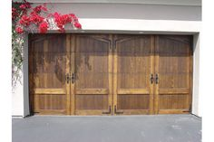 2 car garage doors | double garage door made to look like two single wood garage doors ...