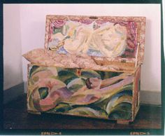 Nude swimmer /Chest, linen chest, date unknown, painted wood and upholstery, decorated by Duncan Grant in 1917, maker unknown, Charleston, England, 49 cm x 93.5 cm x 42.5 cm.  © The Charleston Trust.