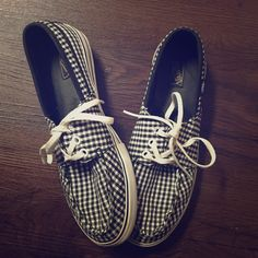 Vans Checkered Sneakers Black and white Vans checkered sneakers. A few stains can be seen on the bottom white part in the pictures, but laces and pattern remain looking like new. Women's size 9. Vans Shoes Sneakers