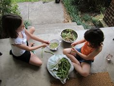 Shelling beans on the front porch.  I always enjoyed doing this with my grandmother. OMG!!!!!! I DID THIS WITH MY GRANDMA!!!!! I MISS HER TERRIBLY!!!!!