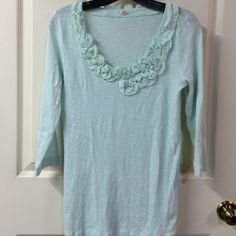 J. Crew mint top J. Crew mint 3/4 sleeve top w/ruffle neckline. Light weight fabric. EUC - no flaws. Could wear alone or easily layered. Size S. Please ask any questions prior to purchasing. Thank you! J. Crew Tops