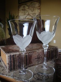 I had a complete set of 6 of these in the original box. Sold them at a yard sale...is it too late to smack myself upside the head?? I loved these. Cris DArques Durand Frosted Petal Crystal Stemware TYCAALAK