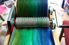 blending  fibers on a drum carder