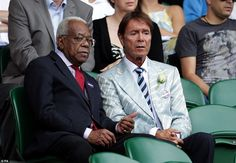 Sir Trevor took a seat alongside Cliff Richard who put on a dapper display in a grey striped jacket to which he'd pinned a white rose
