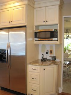 Combo of glazed cabinets, wood floor, & BEIGE walls
