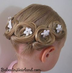 Pin Curl Crown  This special hairstyle holds up all day and is great for the holidays.   Check it out at Babes in Hairland.