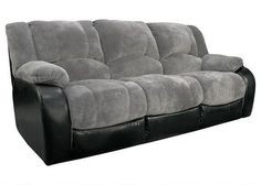 Dynamic Duo. Our Devon gray dual reclining sofa boasts a dual arrangement of fabrics for powerful appeal! Visually, the grey and black colors make a quintessentially sleek statement; texturally, the cozy, velvet-like microfiber contrasts the smooth touch of the faux leather. Comfort-wise, you'll luxuriate in the full-bodied cushions, pillowtop arms and recline options. The reclining seats offer a full chaise design - no gaps between the seat and the footrest - for total body support.