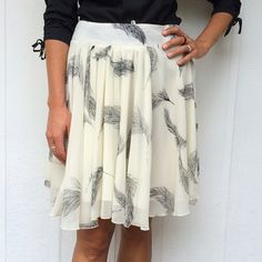Feather skirt Adorable ivory skirt with black feather design • zipper closure in the back • fully lined • worn once • brand FOR CYNTHIA Skirts