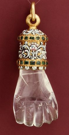 mzteeeyed: queen-yetta-rosenberg: Pendant (in the form of a hand), possibly Spanish, c. 1600-1650. Made of rock crystal, with enameled gold mount set with emeralds