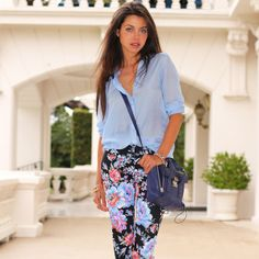 Annabellefleur Wears A Blue Crossbody Bag To Go With Her Fl Pants And Light Blouse