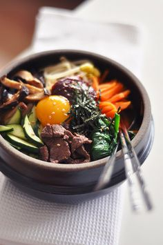 Bibimbap 비빔밥 : Everything (seasonings, rice and vegetables) is stirred together in one large bowl and eaten with a spoon