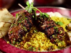 Moroccan Beef Kebabs with Curried Couscous, Raita and Charmoula Vinaigrette recipe from Diners, Drive-Ins and Dives via Food Network