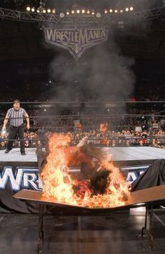 Edge spearing Mick Foley through a flaming table at Wrestlemania 22 Adam Copeland, In This Moment, Wwe, Wcw, Mick Foley, Wwf, Professional Wrestling, Kevin Owens, Wrestlemania