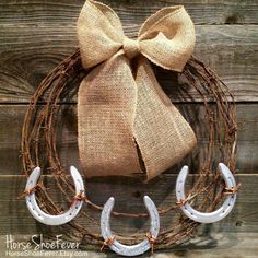 Paint the grapevine wreath turquoise, attach rusty horseshoes and burlap bow!  Cute for bedroom wall above headboard!!