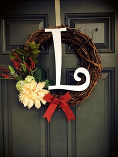 All Season initial wreath #grapevinewreath #woodletter #springsummer