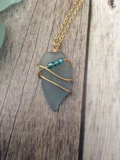 Dainty Blue Sea Glass Necklace by JNsArtnTreasures on Etsy https://www.etsy.com/listing/547161014/dainty-blue-sea-glass-necklace