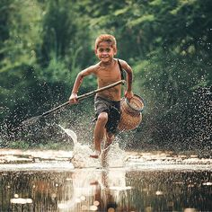Thai child back from fishing - Thailand- Photo by: