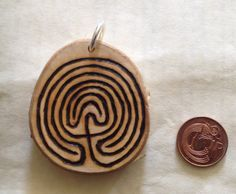 A just finished commission- silver birch (to represent new beginnings) labyrinth with sterling silver ring. About 2 inches across.