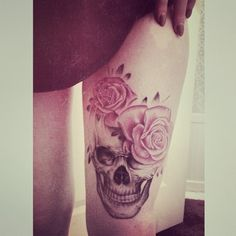 Skull and roses tattoo. Inked Magazine