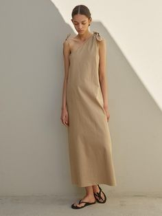 """Design- Unbalanced Ribbon Linen Long Dress- Unbalance shoulder line- Maxi length- Loose fit silhouette- Adjustable shoulder strap- Natural cuttingg hemMeasurementsOne size- Length: 49.6 in- Shoulder: - in- Chest:17.3 inComposition & Care- 55% linen  45% cotton- Dry cleaning- Please check the """"care label""""Designer  - Imported - by ECOMMAE- Style#:300656617* Model Size: 175cm"""